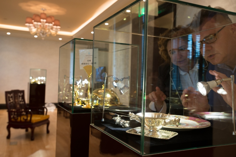 Andreas and Carola Augustin are checking one of the showcases they had set up at the new museum of the People's Grand Hotel Sofitel Legend Xian in China.