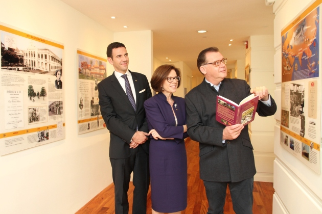 Curator and book author Andreas Augustin takes general manager Amanda Hyndman and hotel manager Marcus Bauder through the new exhibition at The Oriental.