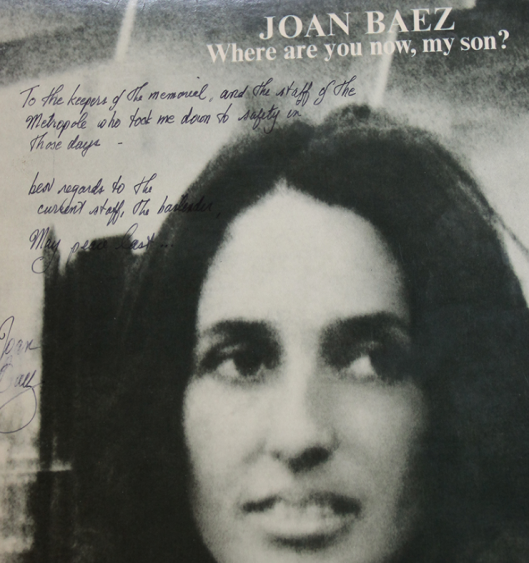 Part of the cover with the autograph of Joan Baez.