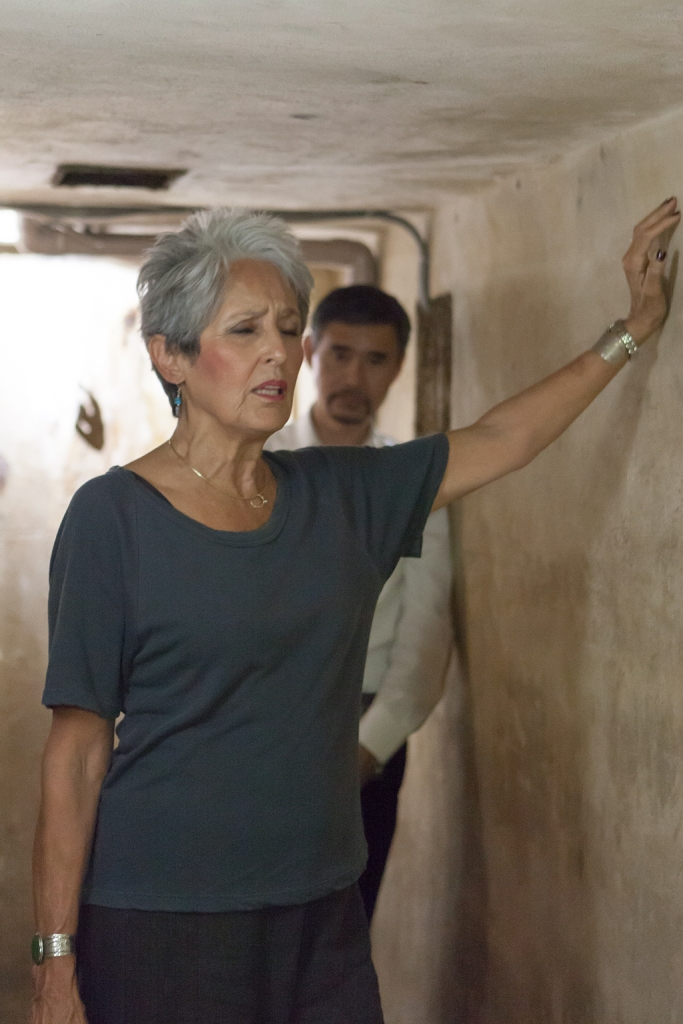Joan Baez - a moving moment of silence - at the Metropole air raid shelter, where she had spent so many fearful moments.