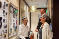 General manager Kai Speth and History Ambassador Duc show Joan Baez through the Path of History